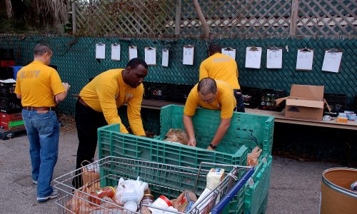 110125-N-6778P-016 TAMPA, Fla. (Jan. 25, 2011) Sailors from the Tampa Bay area volunteer to help the Metropolitan Ministries in sorting out donated food that will feed homeless families during Tampa Bay Navy Week. Navy Weeks are designed to show Americans the investment they make in their Navy and increase awareness in cities that do not have a significant Navy presence. (U.S. Navy photo by Mass Communication Specialist 1st Class Ruben Perez/Released)
